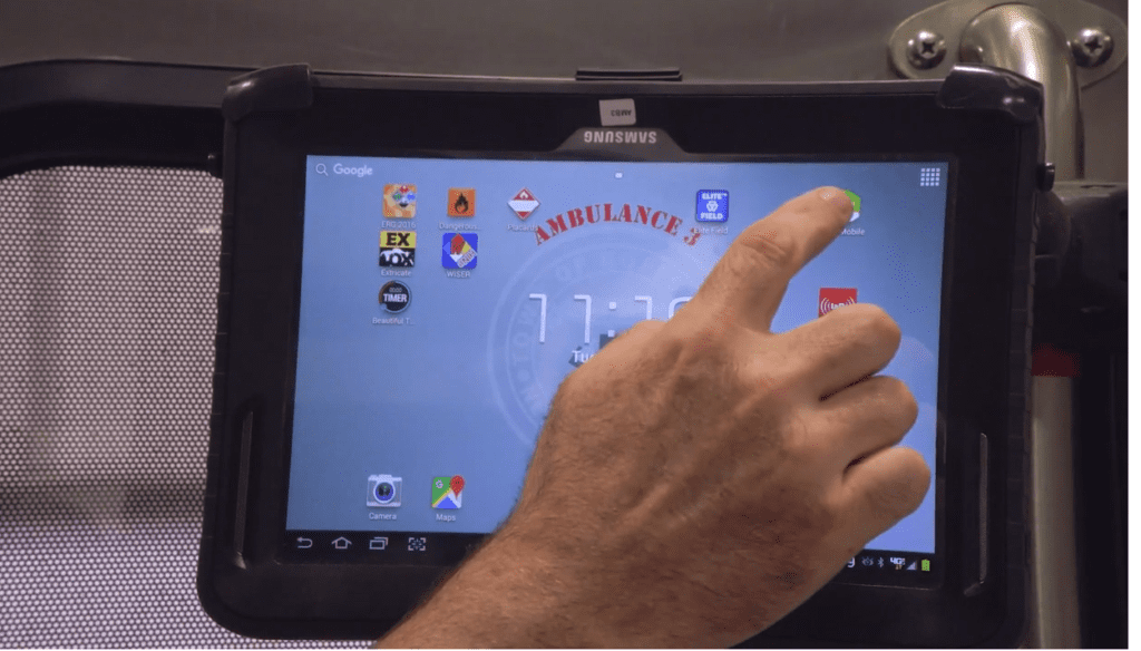 hand clicking on an app on a tablet
