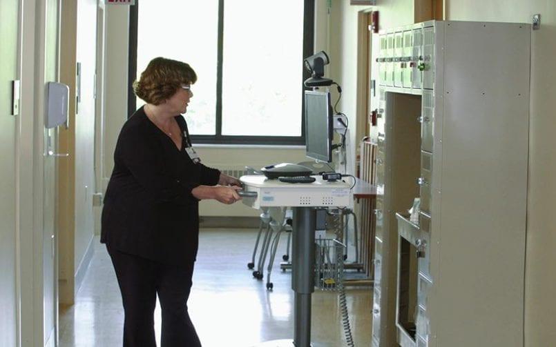 woman working on TeleNeurology services