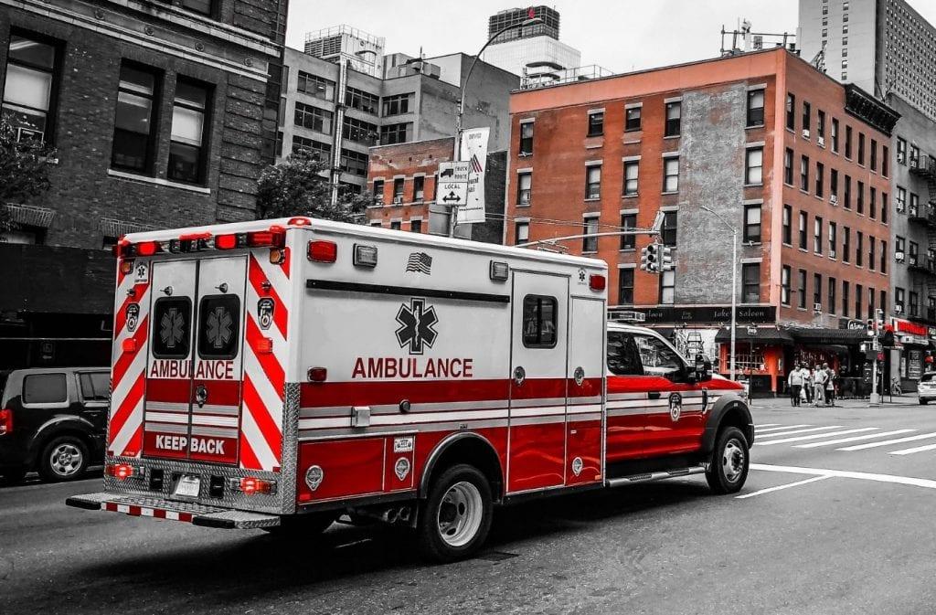 ambulance driving down city street