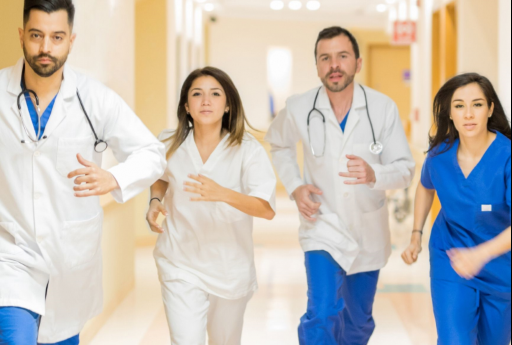doctors and medical staff running down hallway